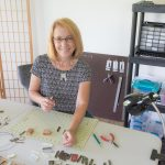 Christine Glade in her studio, crafting XIZOZU™ Medals of Honor.